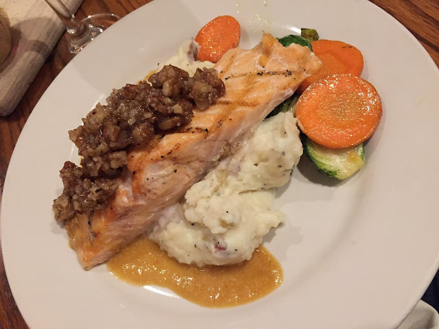 Maple bourbon pecans atop salmon at One Eleven Main in Galena, Illinois