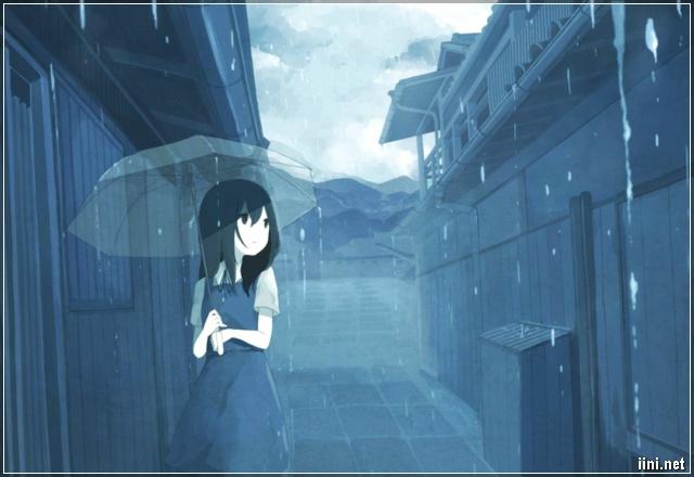 cô gái mang ô đi dưới mưa