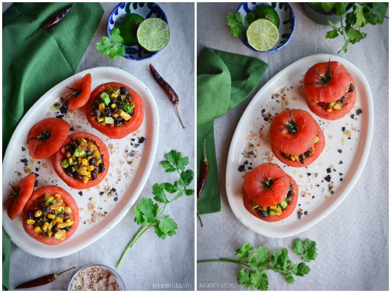 AERIAL VIEW STUFFED TOMATOES IN VINTAGE PORCELAIN DISH, GREEN KITCHEN CLOTH, CILANTRO LEAVES, SALT FLAKES, LIME WEDGES