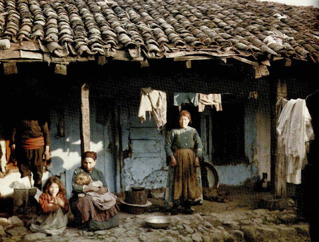 The Jewish ghetto of Bitola known as Jaudihanata (the Jewish Quarter), which was located at current center of the city. The houses are made of stone, clay and wood. Jewish family in the courtyard of their house.. Bitola 1913