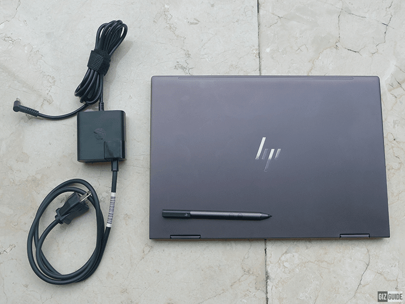 Charger, pen, and the laptop itself