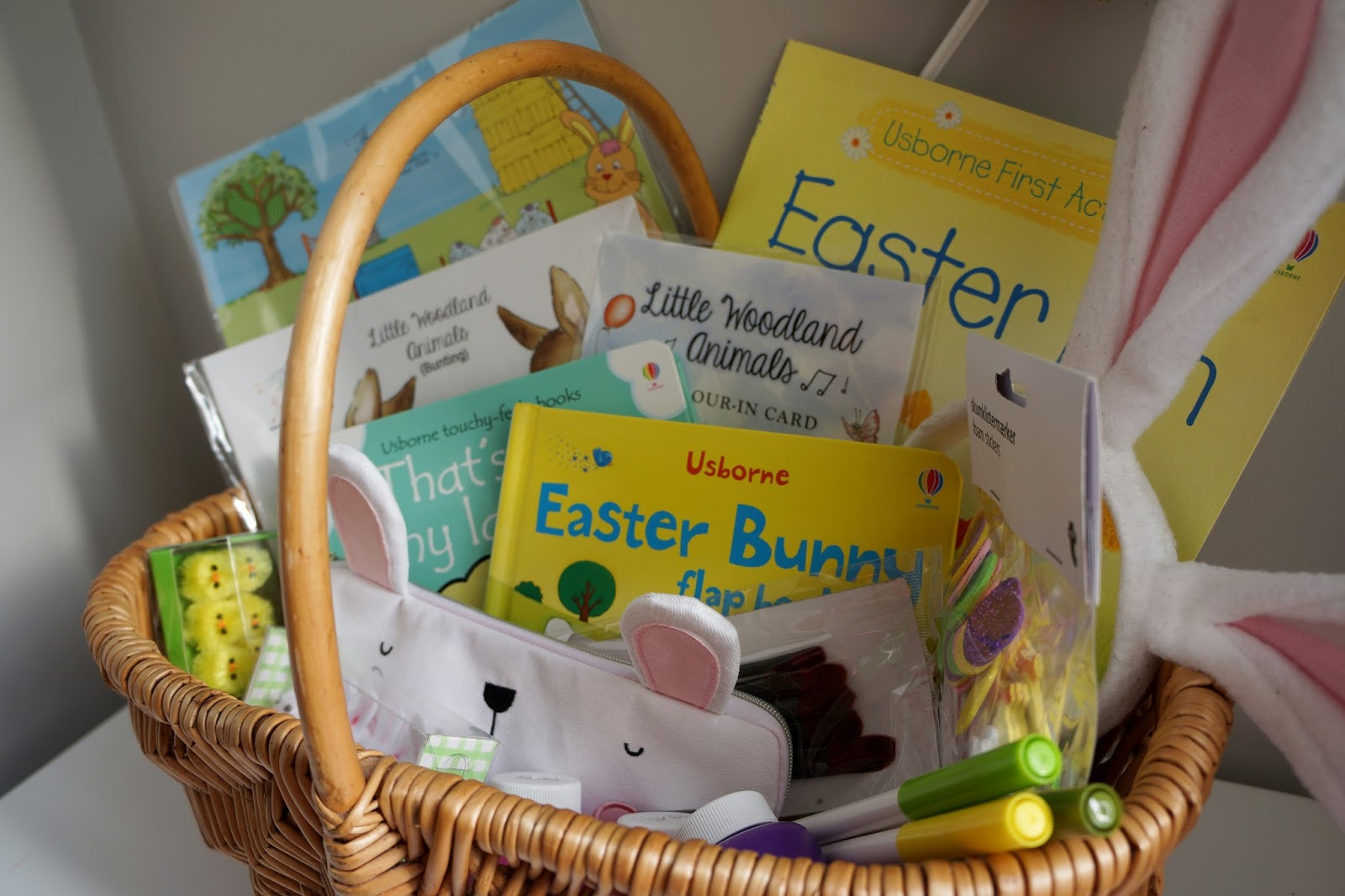 Wicker Easter basket with non-chocolate Easter gift ideas for kids