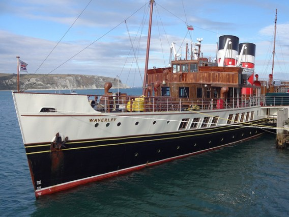 Side view of the PS Waverley tied up at a pier