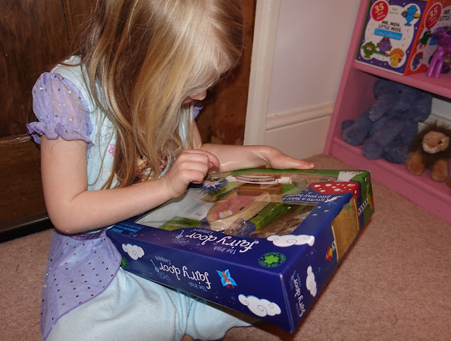 A 5 year old girl looking at the box from the Irish Fairy Door Company