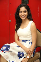 Actress Ritu Varma Stills in White Floral Short Dress at Kesava Movie Success Meet .COM 0200.JPG