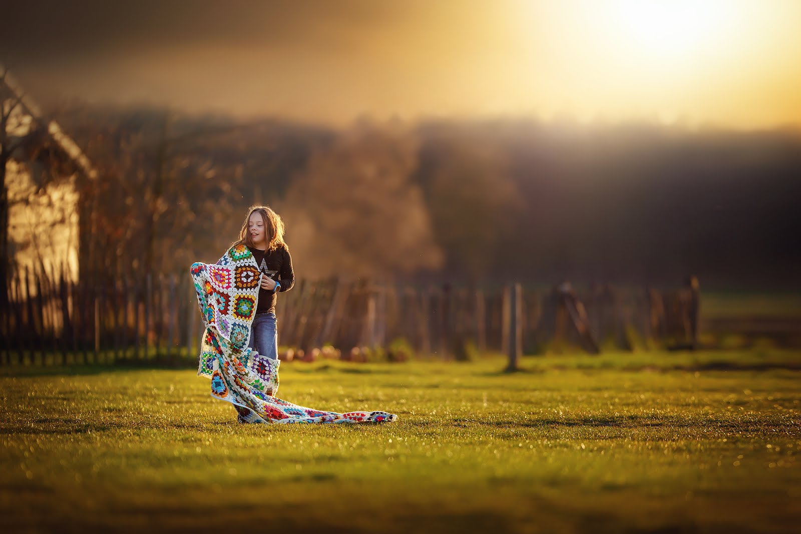 Golden Hour image of a girl walking in the golden hour with a blanket by Willie Kers