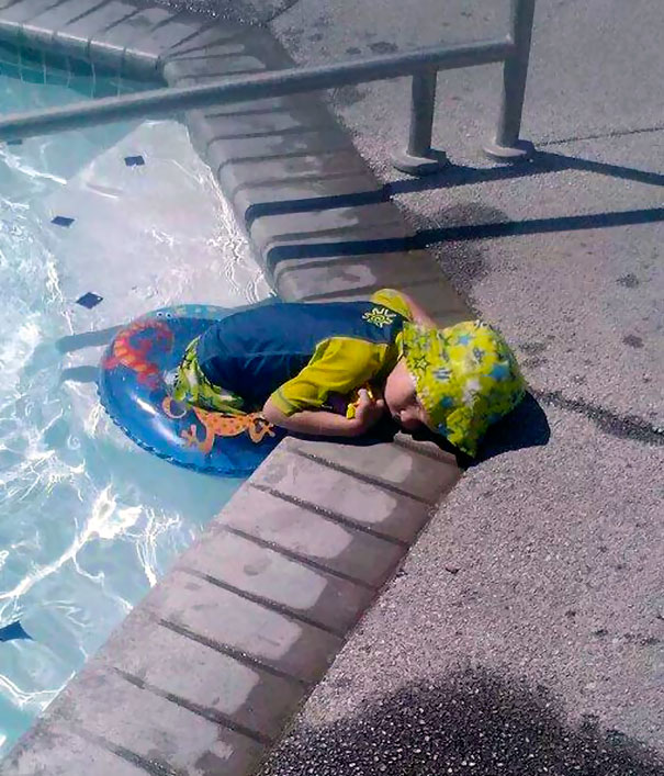 15+ Hilarious Pics That Prove Kids Can Sleep Anywhere - Napping On The Way Out Of Pool