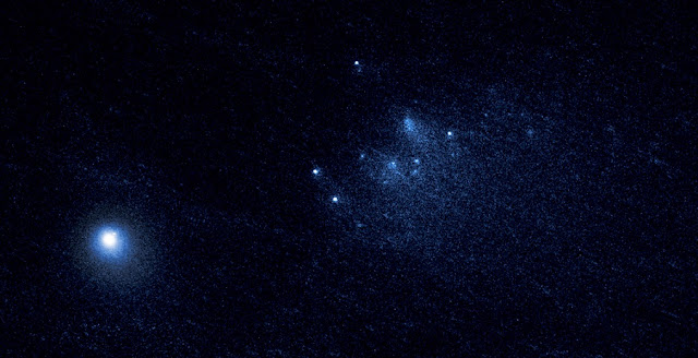 This NASA Hubble Space Telescope image reveals the ancient Comet 332P/Ikeya-Murakami disintegrating as it approaches the sun. The comet debris consists of a cluster of building-size chunks (center) that form a 3,000-mile-long trail. The fragments are drifting away from the comet. The main nucleus of Comet 332P is the bright object at lower left. This observation was made on Jan. 27, 2016, with Hubble's Wide Field Camera. Credits: NASA, ESA, D. Jewitt (UCLA)