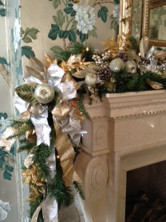Dining Room Mantle In A Beautiful Highland Park Home Decorated With Christmas Greenery White Lights Silver And Gold Ribbons Faux Sugared Fruit