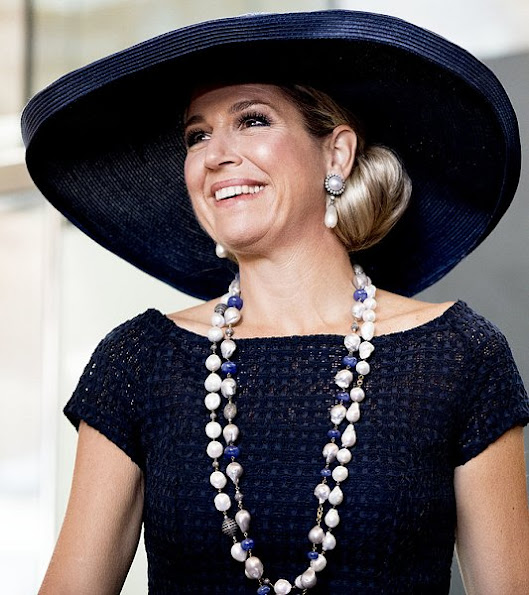 Queen Maxima wore Natan Lace Dress, Natan Pumps, Natan pearl necklace, Pearl Earrings, Velentino Sunglass