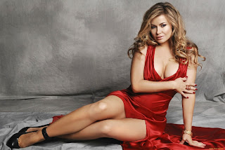 Carmen Electra Sitting On Floor In Fiery Red Dress