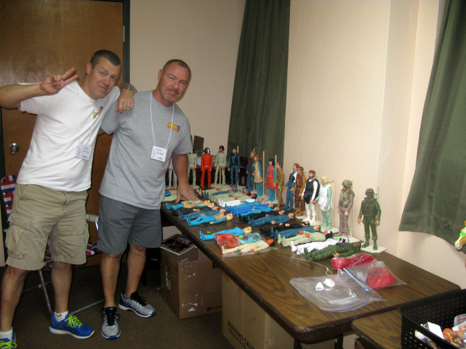 Toph Rodhe and Mike Rodhe show off Mike's custom flocking work on Johnny West figures.