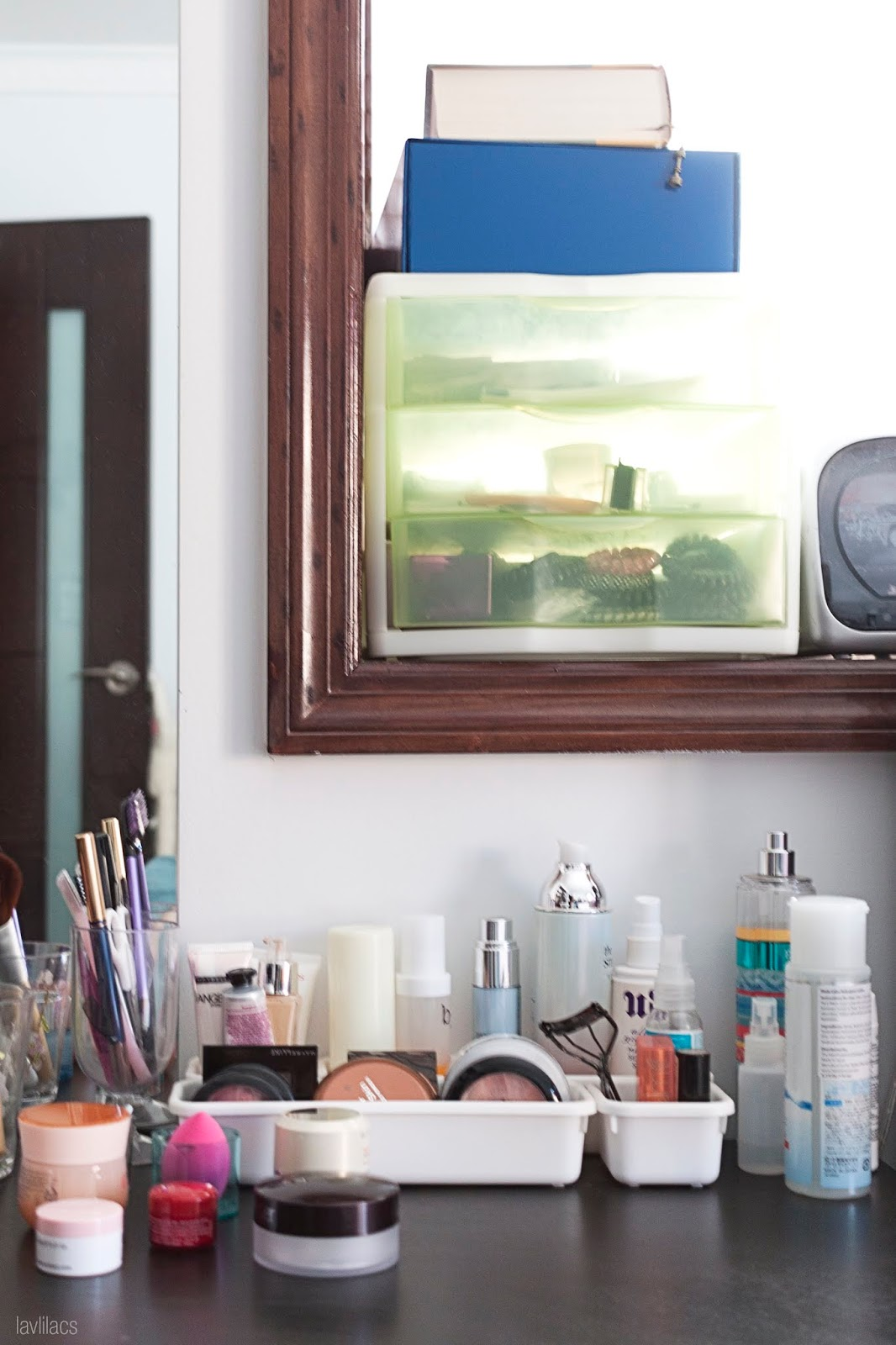 Daily makeup skincare products on top of bedside table portrait view