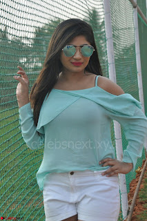 Madhulagna Das looks super cute in White Shorts and Transparent Top 01.JPG