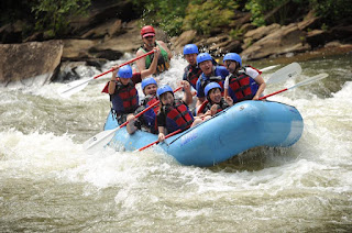 A group of students white water rafting