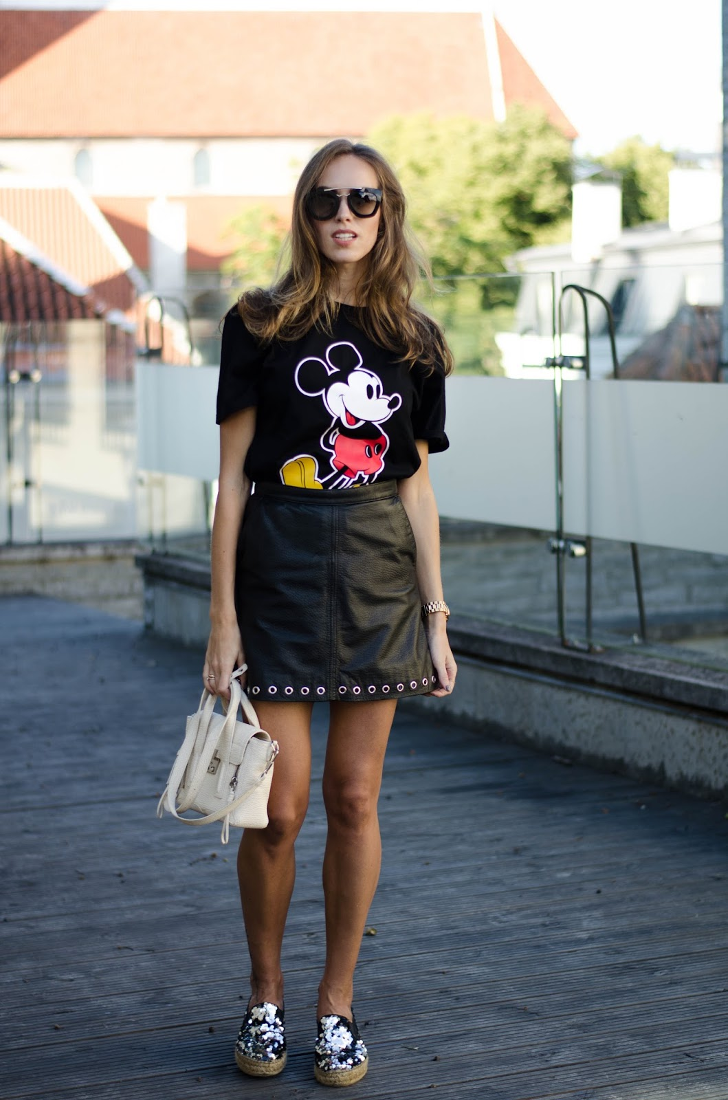 black mickey tshirt leather skirt summer outfit