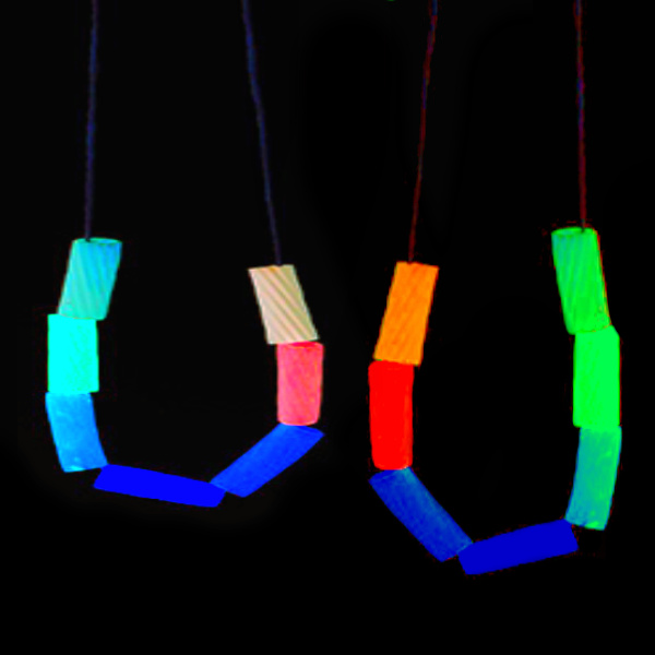 Make pasta necklaces that glow-in-the-dark using this easy neon noodle recipe for kids.  These rainbow dyed noodles can be used in all sorts of other kids activities, too! #glowingrainbownoodles #noodlenecklacesforkids #glowinthedarknoodlenecklace #pastanecklacecraftkids #rainbowdyednoodles #glowingpastanecklace #rainbownoodles #sensoryactivities #sensorybins #growingajeweledrose