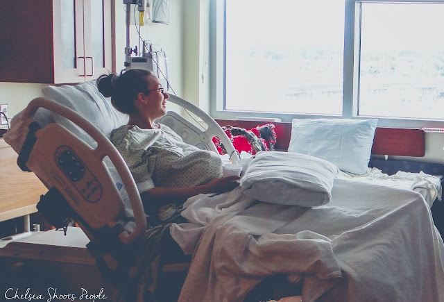 Smiling mom waits in the hospital for her baby to arrive