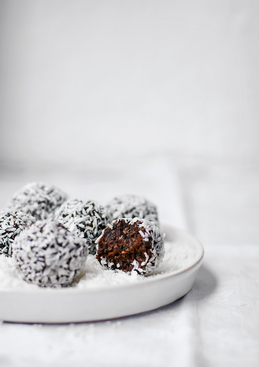 Raw & vegan chocolate coconut bliss balls, like a chocolate bar in energy ball form. These nut-free bites are made with hemp hearts as the base and ultra healthy raw cacao.