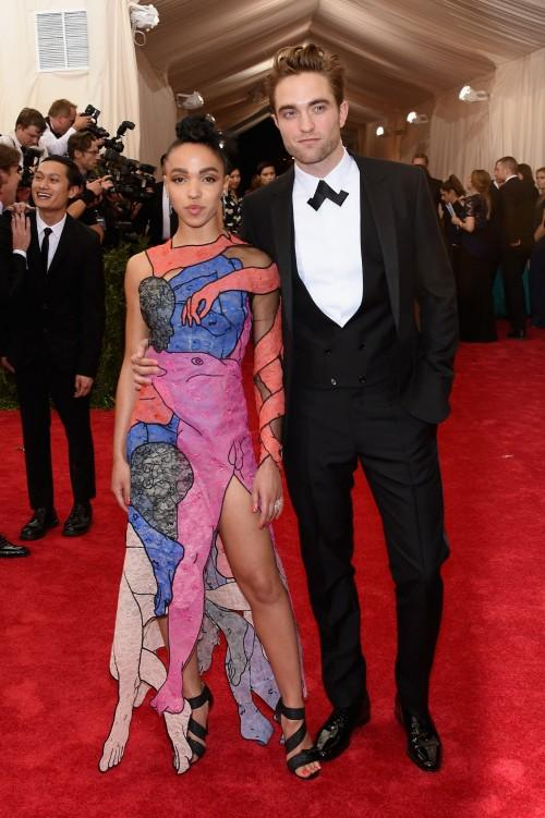 Robert Pattinson in a black Tuxedo and FKA twigs