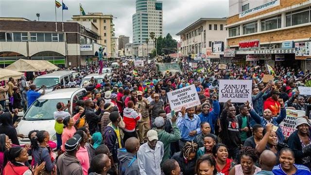Zimbabweans call for Robert Mugabe's resignation at Harare rally