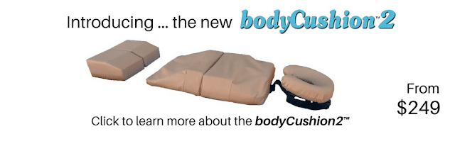 Infographic slide depicting a tan-colored bodyCushion orthopedic cushion. Infographic text reads, 'Introducing ... the new bodyCushion2. From $249. Click to learn more about the bodyCushion2'