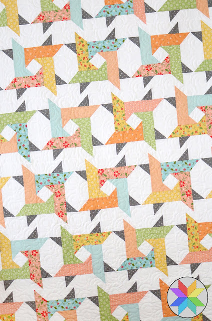 Windy City quilt pattern by Andy of A Bright Corner - perfect for using fat quarters, jelly roll strips, or layer cakes