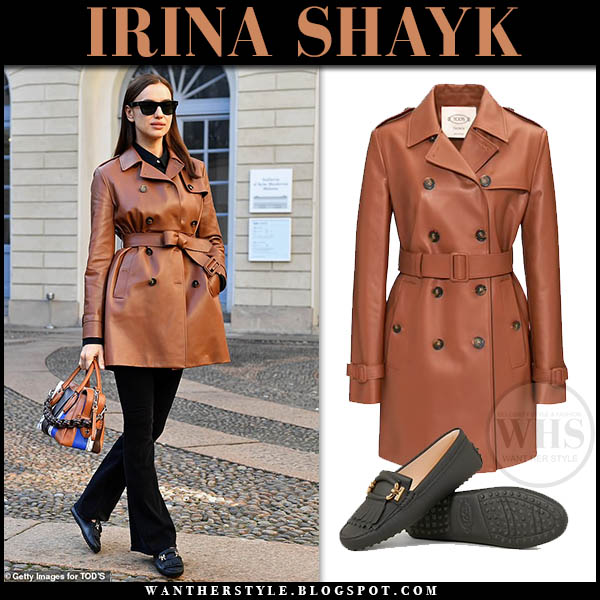 Irina Shayk in brown leather short Tod's trench coat, black trousers and black loafers. Elegant fashion week outfit february 2019