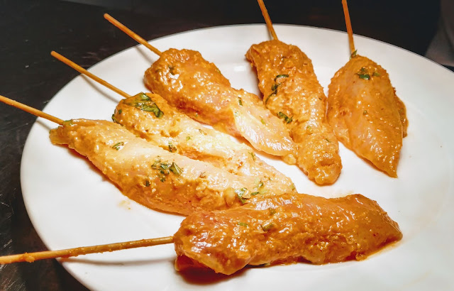 Shewer chicken pieces in wooden stick for chicken satay recipe