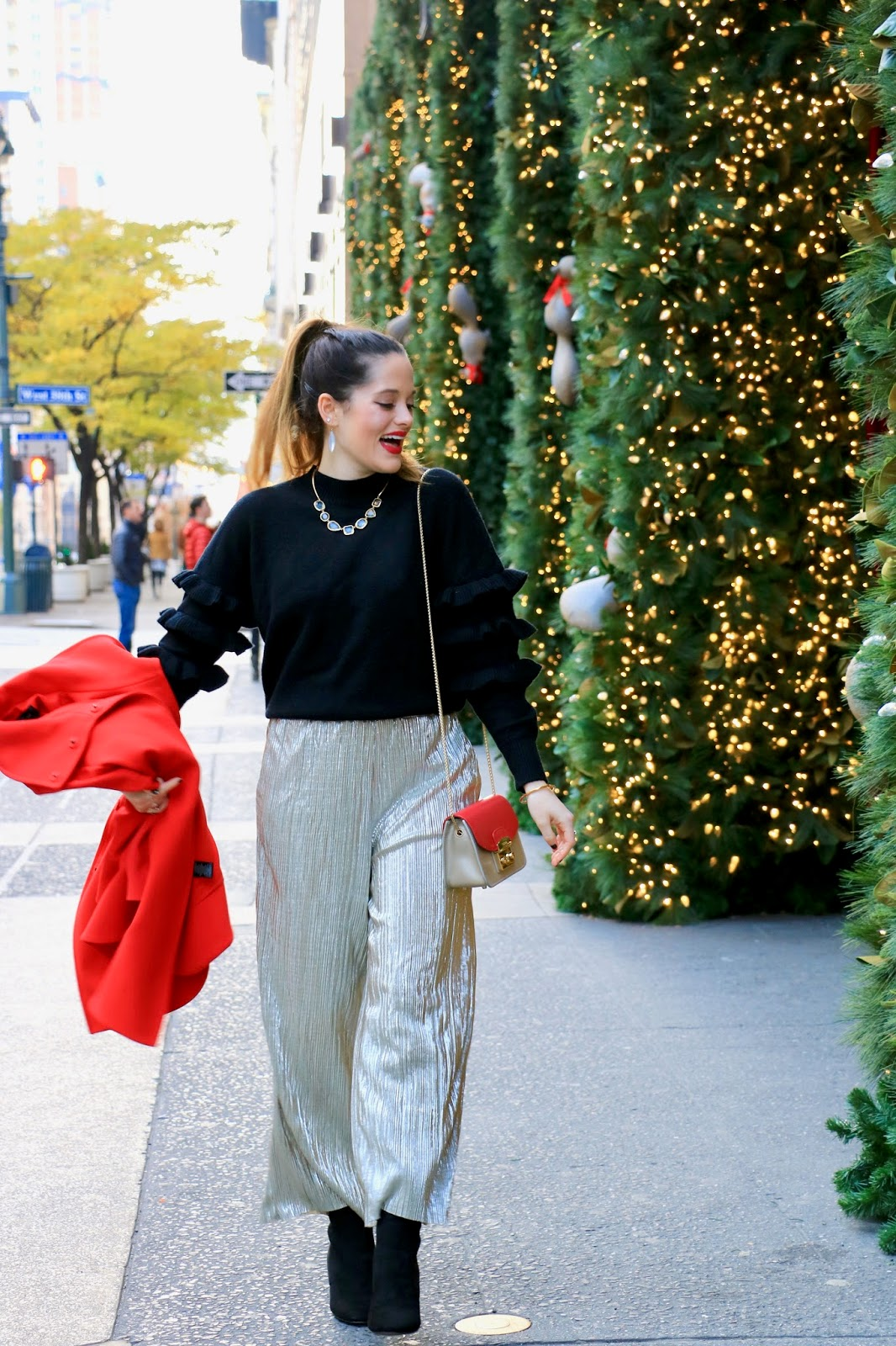 Nyc fashion blogger Kathleen Harper showing how to wear gold pants