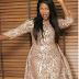 Tiwa Savage dazzles in gold dresss