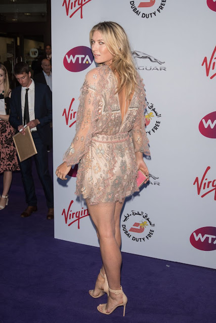 Maria Sharapova stunning leggy poses at WTA party carpet photo 9