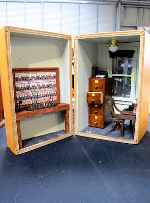 Wooden box containing a one-twelfth scale miniature telephone exchange and office.