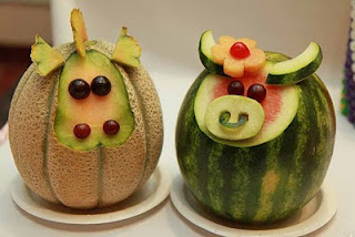 melon animal sculptures for fourth wedding anniversary
