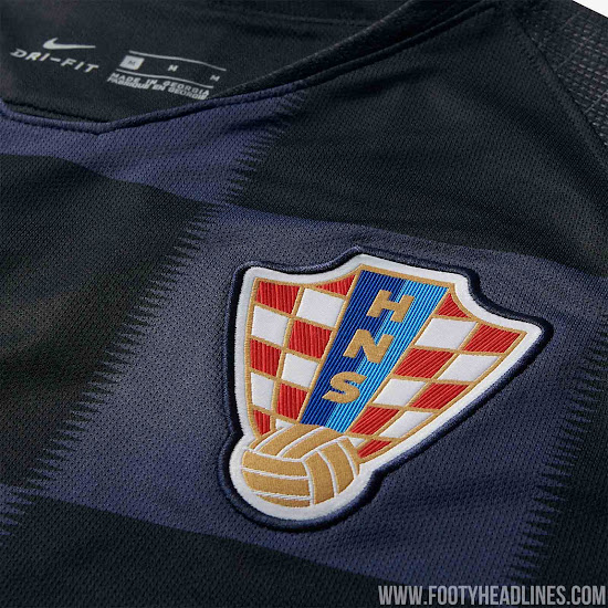 e58c3d286 The sleeves and neck of the Croatia 2018 away kit are solid black with the  former featuring a subtle waveform-like knit pattern. The back is solid  black.