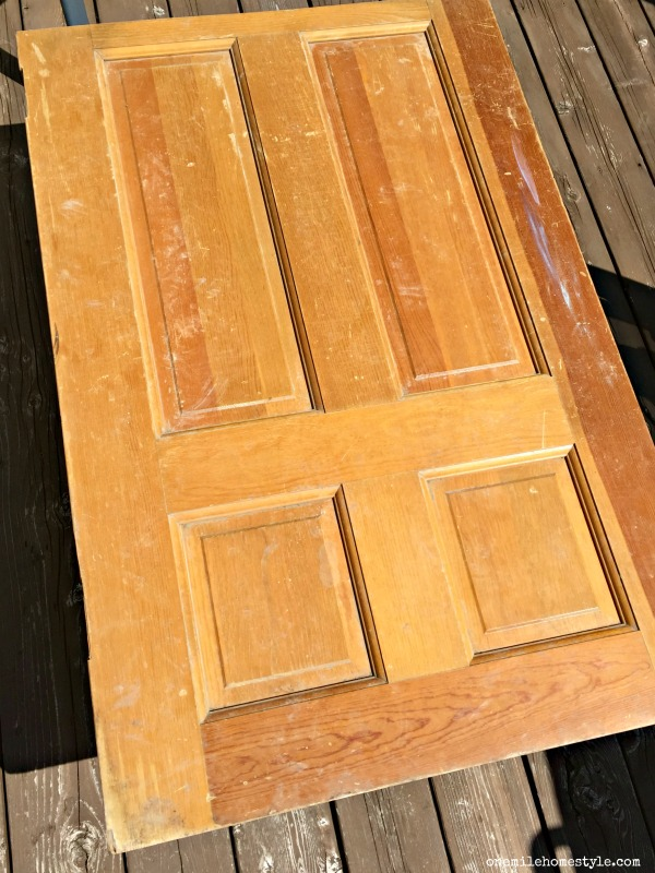 Add rustic farmhouse charm to your home with this easy DIY coffee table made from an old door!