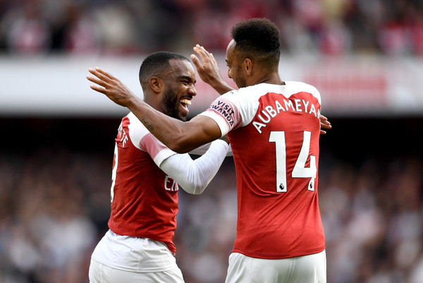 Alexandre Lacazette of Arsenal celebrates his team's second goal with Pierre-Emerick Aubameyang an own goal from Issa Diop of West Ham United (not pictured) during the Premier League match between Arsenal FC and West Ham United at Emirates Stadium on August 25, 2018 in London, United Kingdom. (Aug. 24, 2018 - Source: Clive Mason/Getty Images Europe)