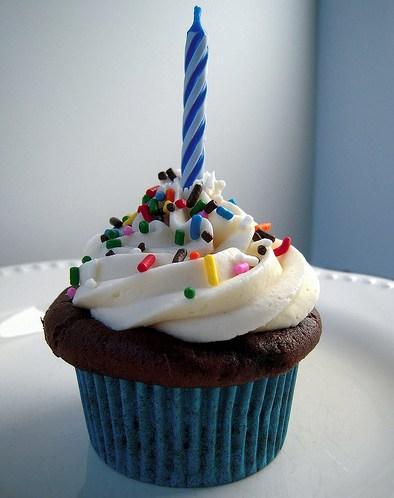 cupcake with birthday candle - IMAGE VIA THECUPCAKEBLOG.COM