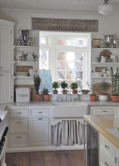 Charming European farmhouse kitchen with farm sink linen skirt in beach cottage by Brooke Giannetti