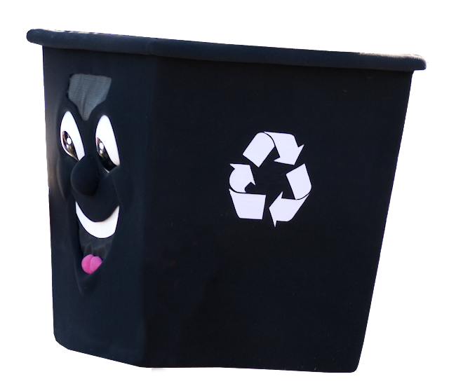 A large black plastic bin for recycling.