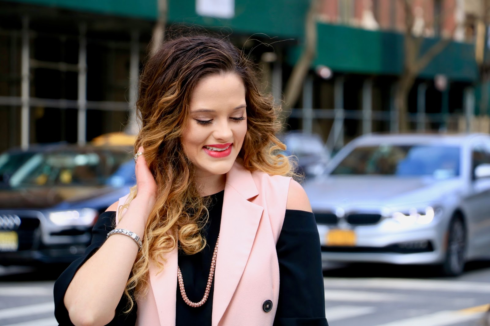 Nyc fashion blogger Kathleen Harper shows how to wear a sleeveless coat