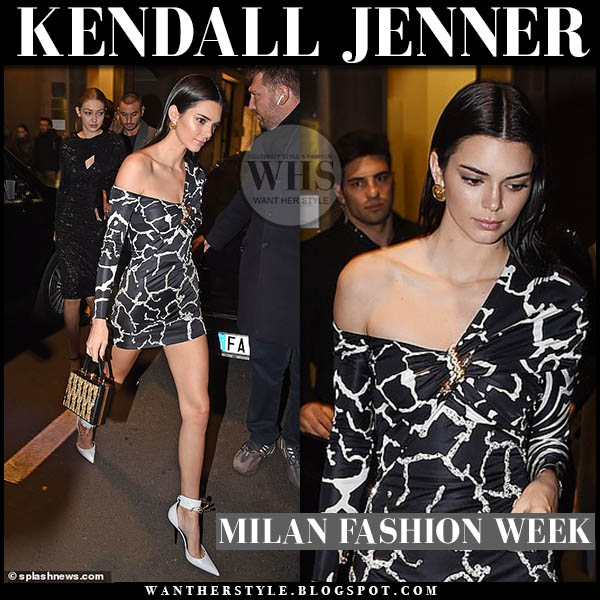 d2d56a633fa Kendall Jenner wears black printed one shoulder Versace mini dress and white  pumps. Fashion week