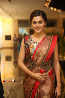 Tapsee Pannu Latest Stills in Red Silk Saree at Anando hma Pre Release Event .COM 0013.JPG