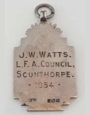 Picture one of football medal awarded to a Brigg official in 1923