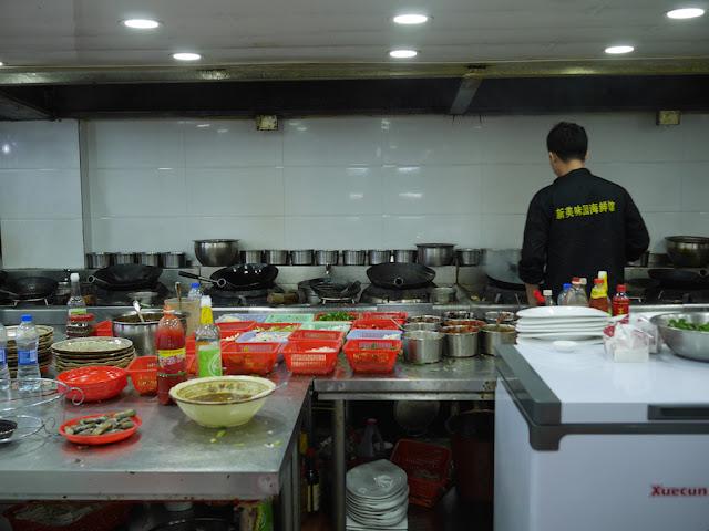 kitchen at Xinmeiweiyuan Restaurant in Xiapu, China