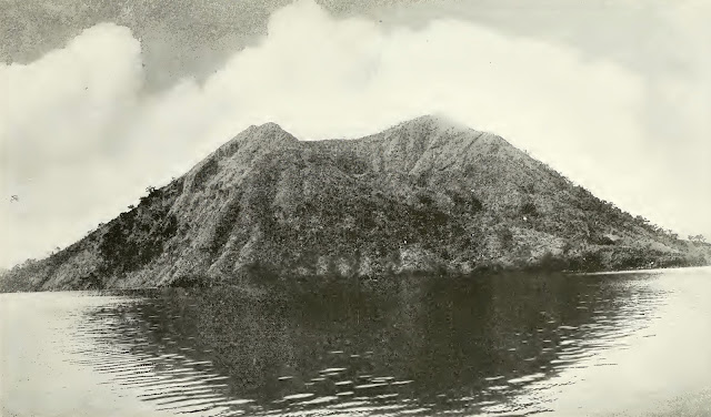 """A peaceful neighbor of Mount Taal, Binintiang Malaqui.  This crater,  at the extreme northwestern extremity of Volcano Island, """"burst forth with a tremendous display of thunder and lightning"""" in 1707, but it has been quiet ever since."""