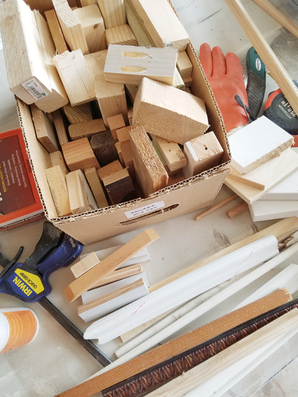 molding and various pieces of wood inside box - Irwin clamp