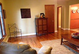 Living room with wood floor chairs and cabinet