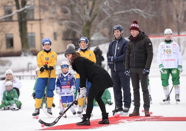Kate Middleton wore Burberry Double breasted suede trench coat at a Bandy hockey match at Vasaparken in Stockholm