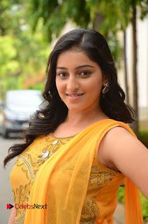 Actress Mouryani Pictures in Yellow Long Dress at Ardhanaari Teaser Launch  0050.JPG